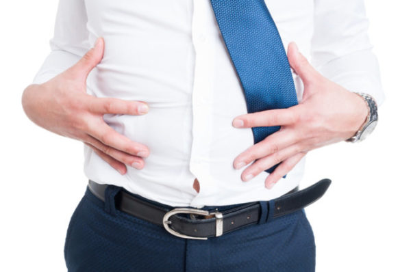 businessman-in-closeup-holds-his-stomach-because-of-bloating